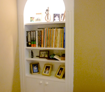 Handmade alcove shelving and cupboard